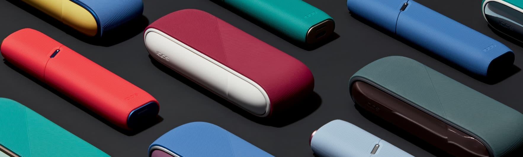 IQOS com capas de porta e mangas de silicone
